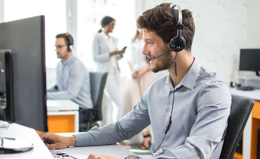 Man with headset works on the computer