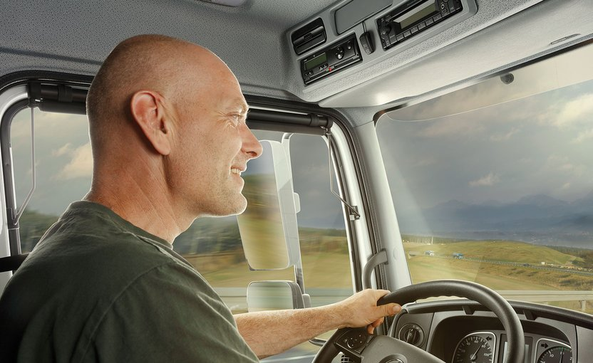 Man in a vehicle is talking on the phone in hands-free mode